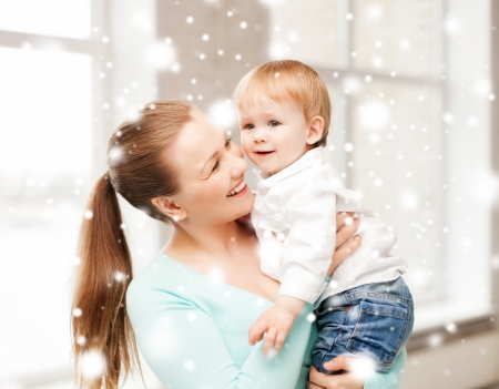 family, children, christmas, x-mas, love concept - happy mother with adorable baby photo