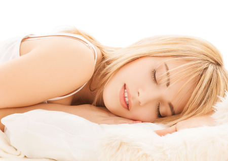 health and beauty concept - teenage girl sleeping at home photo