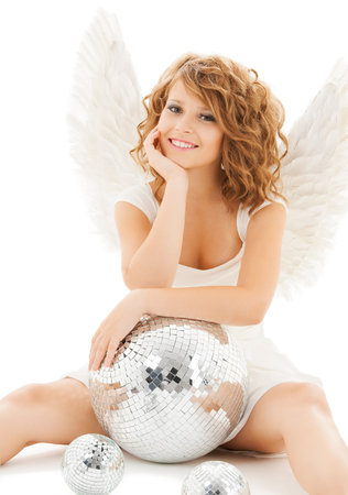 holidays and costumes concept - happy teenage angel girl with disco ball photo