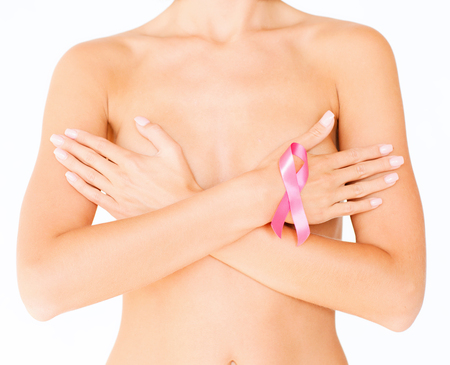 cancer: health, medicine, beauty concept - naked woman with breast cancer awareness ribbon Stock Photo