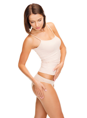 slimming: health and beauty - woman in cotton underwear showing slimming concept Stock Photo