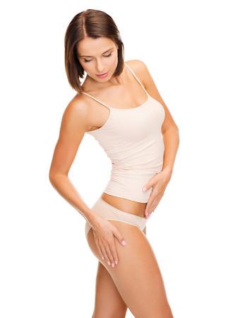 tanque: salud y belleza - mujer en ropa interior de algodón que muestra el concepto de adelgazamiento Foto de archivo