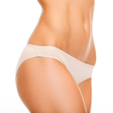 abdomens: health and beauty - woman in cotton underwear showing slimming concept Stock Photo