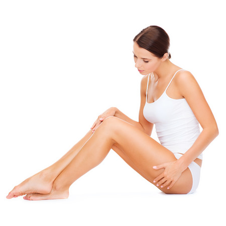 sit shape: health and beauty concept - beautiful woman in white cotton underwear