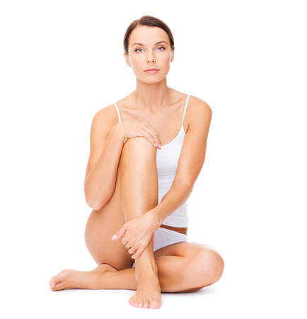 chiropody: health and beauty concept - beautiful woman in white cotton underwear