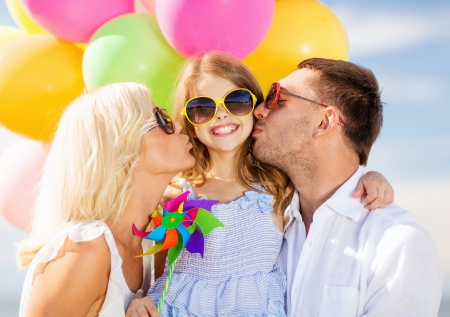 summer holidays, celebration, children and people concept - family with colorful balloons Stock Photo - 22381577