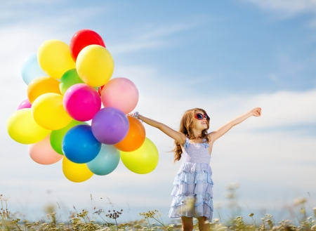 birthday party kids: summer holidays, celebration, family, children and people concept - happy girl with colorful balloons