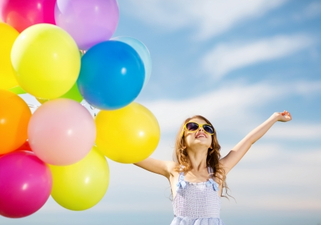 summer holidays, celebration, family, children and people concept - happy girl with colorful balloons Stock Photo - 22381606