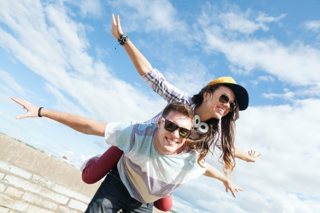 teenage: summer holidays and teenage concept - teenagers having fun outside