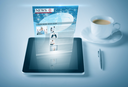 business and technology concept - tablet pc with news feed photo