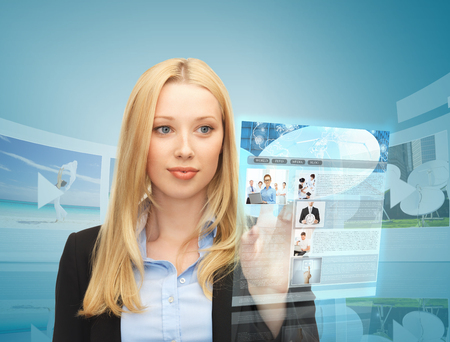 reading news: business, technology, internet and news concept - woman with virtual screen reading news Stock Photo