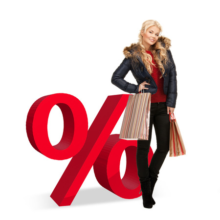 big sale: woman with shopping bags and big red percent sign