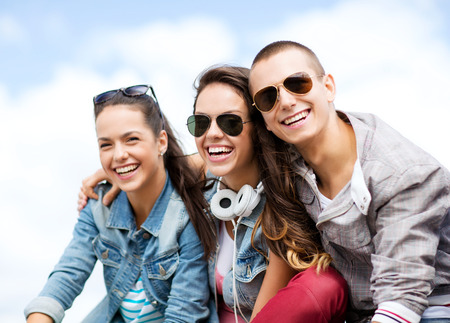 an old friend: summer holidays and teenage concept - group of teenagers hanging outside Stock Photo