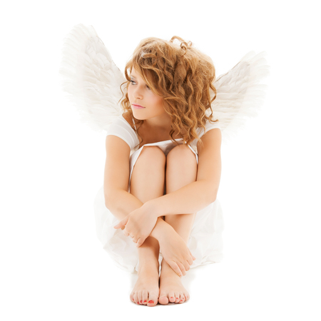 holidays and costumes concept - sad teenage angel girl photo