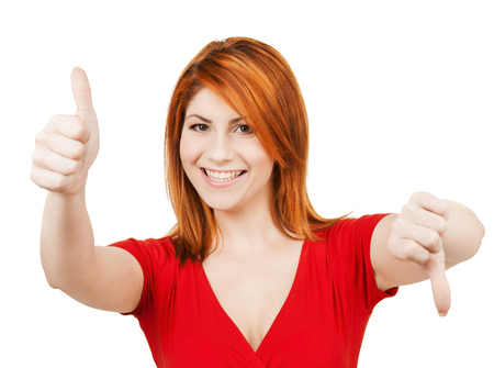 up and down: business concept - businesswoman with thumbs up and down Stock Photo