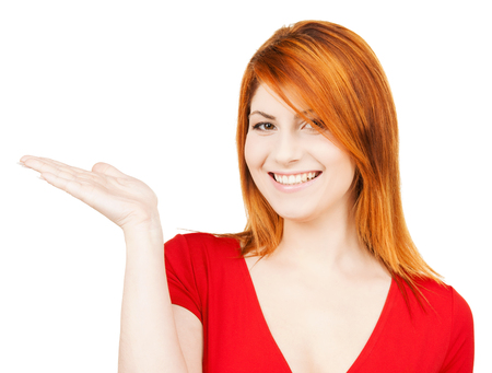 woman showing something on the palm of her hand photo