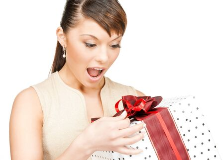 celebration, holidays, xmas concept - happy woman with gift box photo