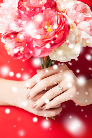 love, romance, bridal, marriage, jewelry concept - woman hands with bouquet of flowers and wedding ring Stock Photo - 22641648