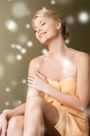 health and beauty concept - happy woman in spa salon photo