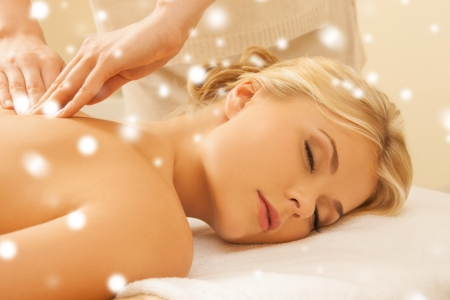 woman massage: health and beauty concept - woman in spa salon getting massage Stock Photo