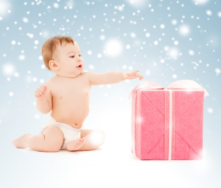 holidays, presents, christmas, x-mas, birthday concept - happy child with gift box photo