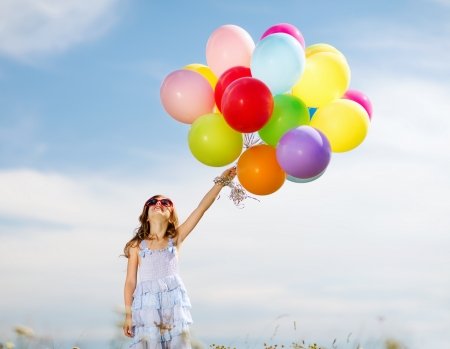 family celebration: summer holidays, celebration, family, children and people concept - happy girl with colorful balloons