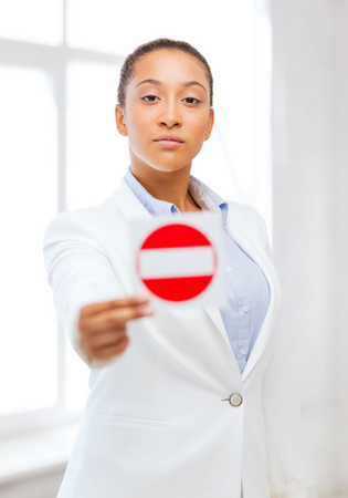 business, protest, racism concept - african woman showing stop sign Stock Photo - 22641972