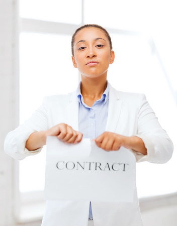 business and office, legal concept - african businesswoman tearing contract