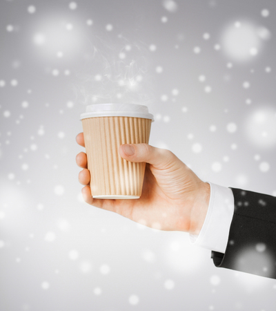 fast food concept - man hand holding take away coffee cup photo