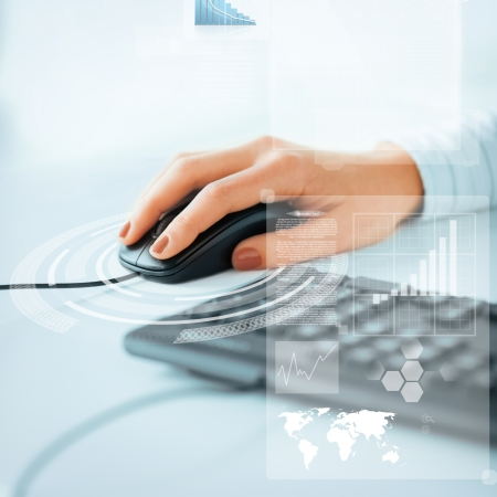 digital learning: business, office, school and education concept - woman hands with keyboard and mouse