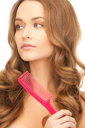 health and beauty concept - beautiful woman with long hair and pink brush photo