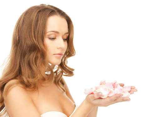 anti aging: health and beauty concept - beautiful woman with rose petals