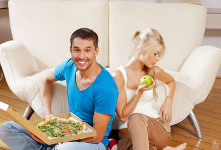 bad apple: healthy and unhealthy nutrition concept - bright picture of couple eating different food