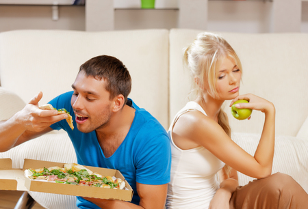 healthy and unhealthy nutrition concept - bright picture of couple eating different food photo