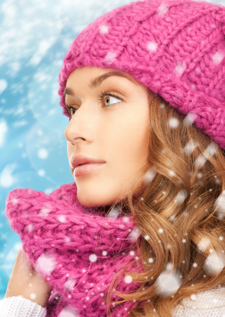 winter, x-mas, people, happiness concept - woman in hat and scarf photo