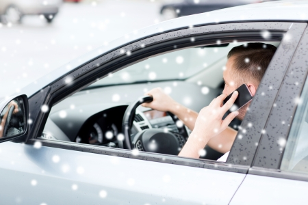 transportation and vehicle concept - man using phone while driving the car Stock Photo - 22708092