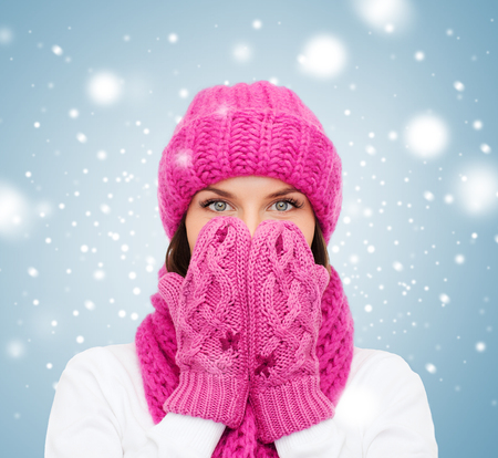 muffler: christmas, x-mas, winter, happiness concept - surprised woman in hat, muffler and mittens