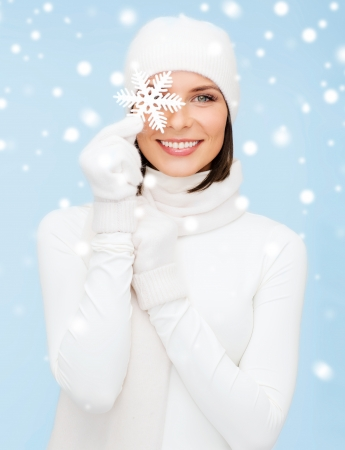 gloves women: winter, people, happiness concept - woman in hat, muffler and gloves with big snowflake Stock Photo