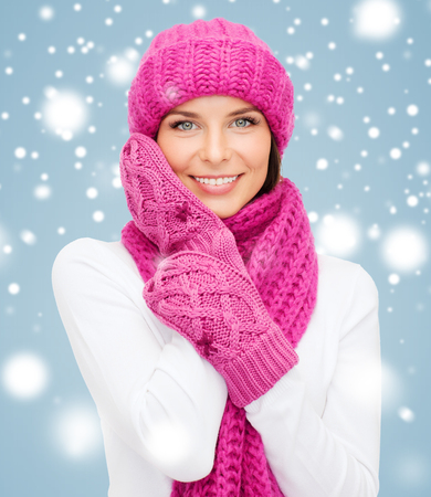 winter, people, happiness concept - woman in hat, muffler and mittens photo