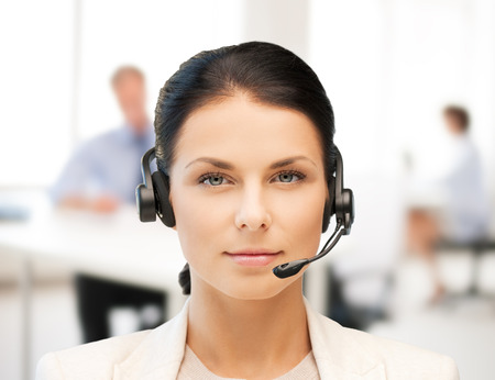 business, communication and call center - female helpline operator with headphones photo