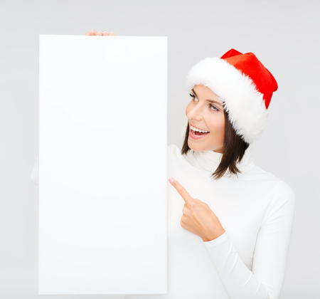 santa helper: christmas, x-mas, people, advertisement, sale concept - happy woman in santa helper hat with blank white board