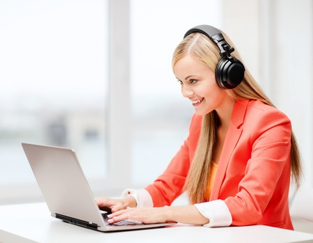 leisure, music, free time, online and internet concept - happy woman with headphones listening to music 版權商用圖片 - 22708508