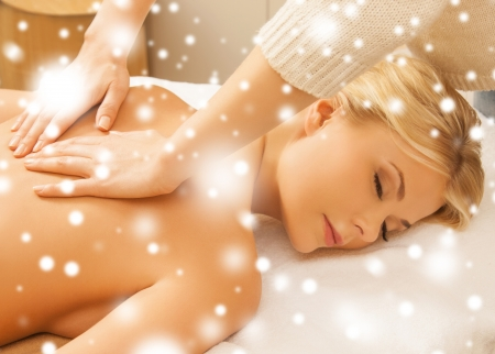 health and beauty concept - woman in spa salon getting massage Stock Photo