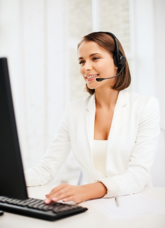 business, communication and call center concept - friendly female helpline operator with headphones photo