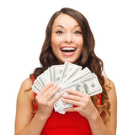 コンセプト - 笑みを浮かべて赤いドレスの女私たちドルのお金を銀行のクリスマス、クリスマス、販売 写真素材