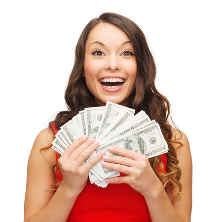 us  money: christmas, x-mas, sale, banking concept - smiling woman in red dress with us dollar money