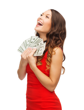 christmas, x-mas, sale, banking concept - smiling woman in red dress with us dollar money