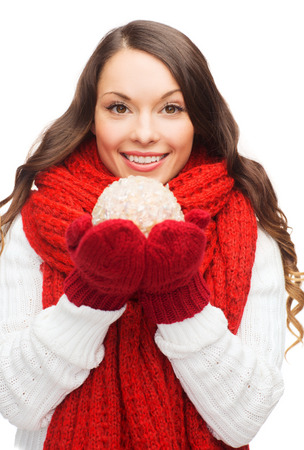 sweater girl: winter, people, happiness concept - happy woman in scarf and mittens with christmas ball