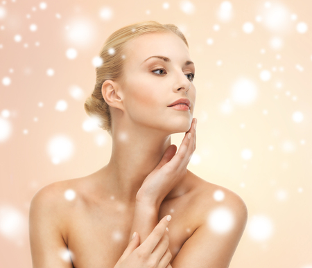 soft skin: health, spa, beauty concept - face, hands and shoulders of beautiful woman