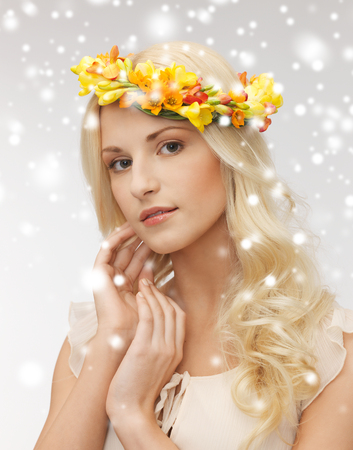 health and beauty, bridal concept - young woman wearing wreath of flowers photo